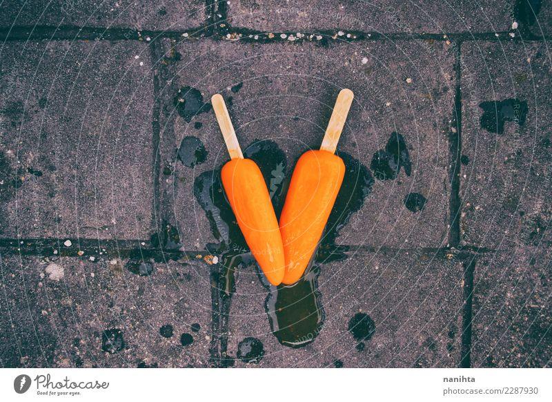 Sommer Essen Zeit Lebensmittel grau orange Ernährung dreckig authentisch Speiseeis nass Wandel & Veränderung einfach Neugier Sommerurlaub Tropfen