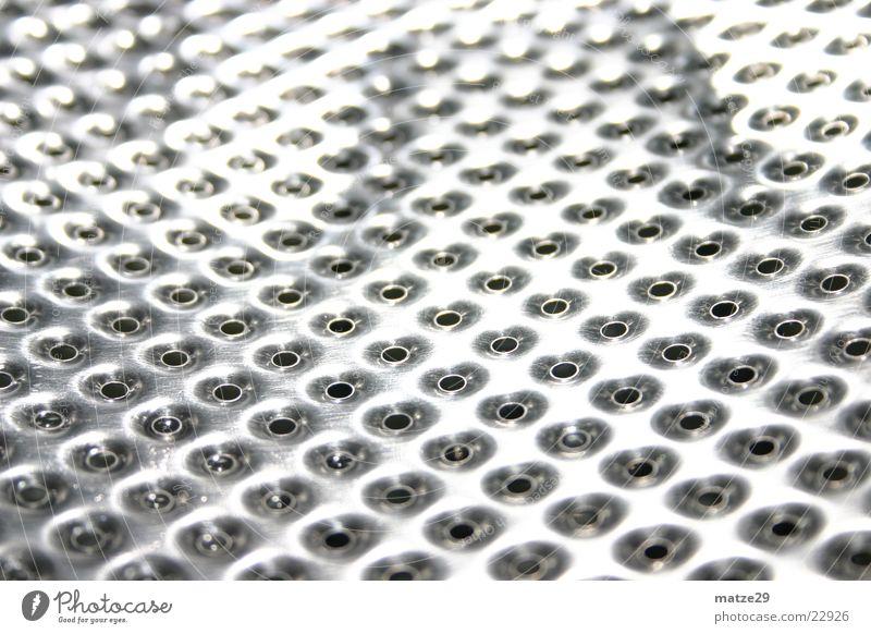 Waschtrommel Wäschetrommel Waschmaschine Aluminium Edelstahl Loch Makroaufnahme Nahaufnahme Reflektion
