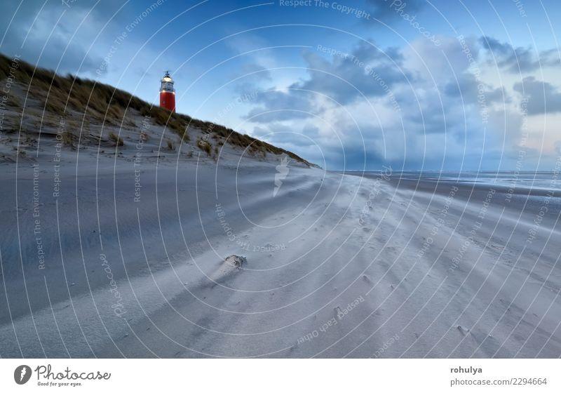 Leuchtturm an der Nordseeküste in der Abenddämmerung und starkem Wind Ferien & Urlaub & Reisen Strand Meer Natur Landschaft Sand Himmel Wolken Horizont