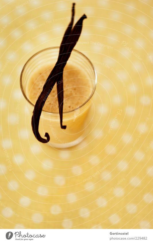 Vanille Lebensmittel Frucht Bioprodukte Getränk Glas gelb gepunktet Vanilleschote Saft Foodfotografie Mixgetränk Cocktail Farbfoto Innenaufnahme