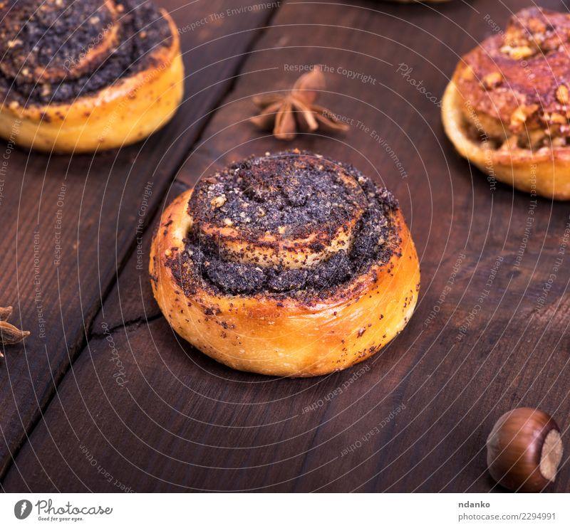 Essen natürlich Holz braun oben frisch Tisch Küche lecker Frühstück Tradition Mohn Dessert Backwaren Brötchen rustikal