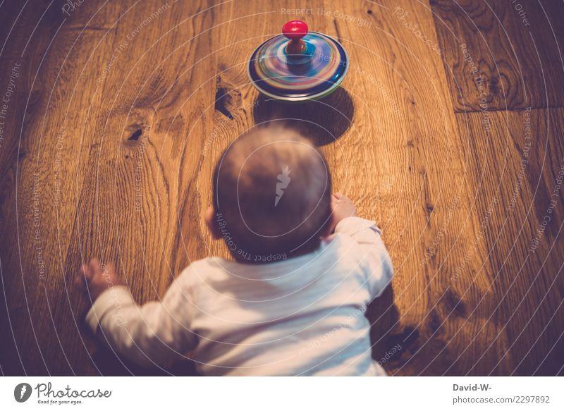 Das Baby und der Kreisel Lifestyle Freude schön Gesundheit Leben Zufriedenheit Spielen Häusliches Leben Wohnung Mensch Kind Kleinkind Eltern Erwachsene Kindheit