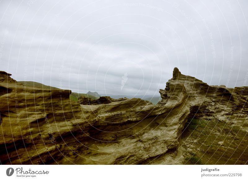 Island Umwelt Natur Landschaft Urelemente Himmel Felsen Vulkan Dyrhólar außergewöhnlich dunkel natürlich wild Stimmung Gesteinsformationen Stein