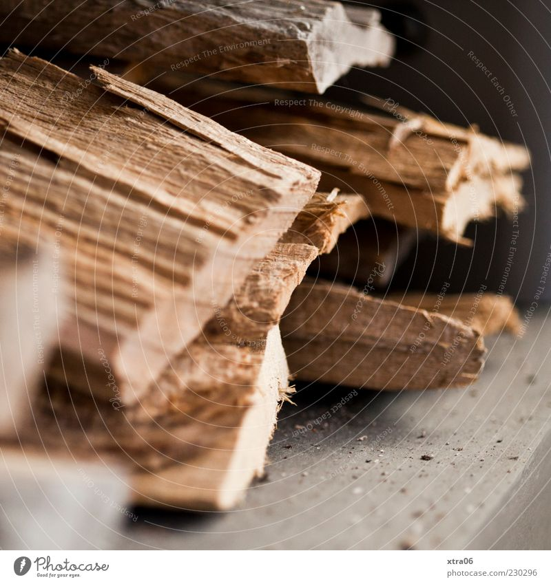 holz Holz braun heizen Brennholz Farbfoto Innenaufnahme Stapel gelagert mehrere Holzstapel Detailaufnahme Menschenleer Unschärfe Textfreiraum unten
