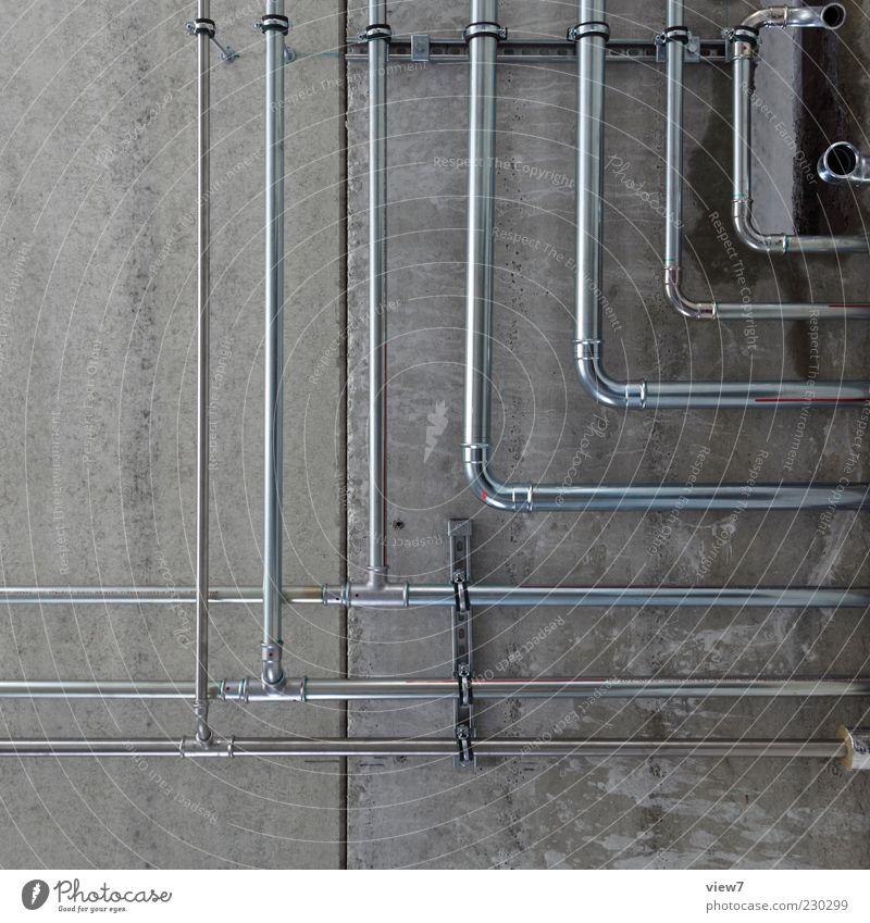 Leitungen ++ Energiewirtschaft Mauer Wand Fassade Stein Beton Metall Linie dünn einfach modern grau Abzweigung Installateur Gasleitung Heizung innenausbau