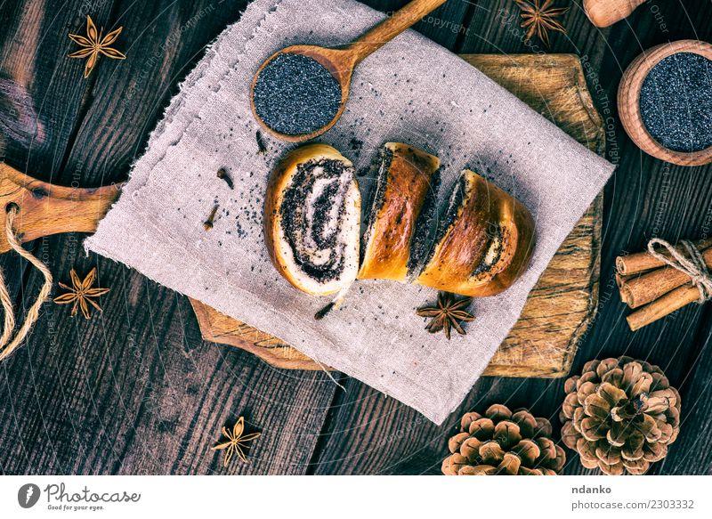 hausgemachte Brötchen mit Mohn Brot Dessert Löffel Tisch Holz Essen frisch lecker oben braun Tradition rollen Biskuit Schneidebrett gebastelt geschnitten