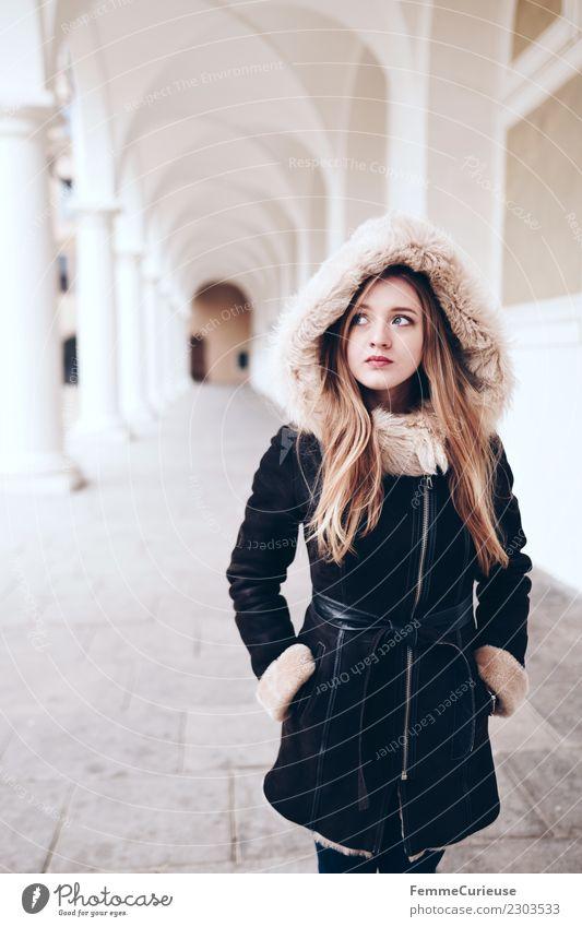 Young woman is standing in a hallway with white columns Lifestyle elegant Stil feminin Junge Frau Jugendliche Erwachsene 1 Mensch 18-30 Jahre schön Winter