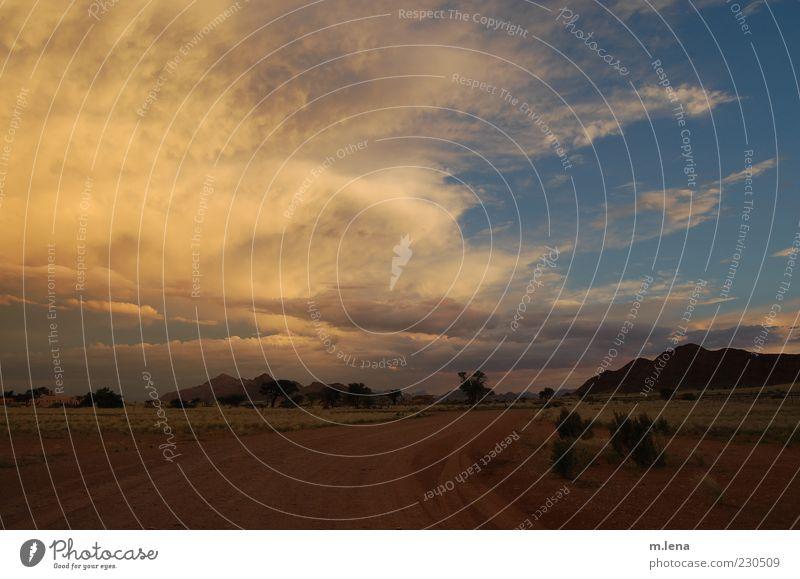 colorful clouds Himmel blau Sommer Wolken gelb Straße Landschaft Berge u. Gebirge Wege & Pfade Sand Luft Stimmung Wetter braun ästhetisch authentisch