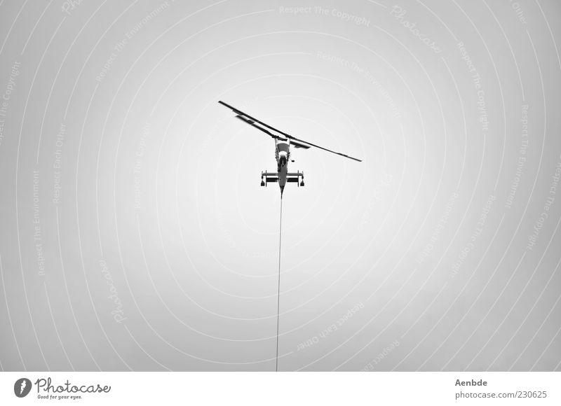 you&me Kabel Luftverkehr Himmel Verkehrsmittel Hubschrauber Rettungshubschrauber hängen tragen werfen Aggression außergewöhnlich schwarz silber weiß