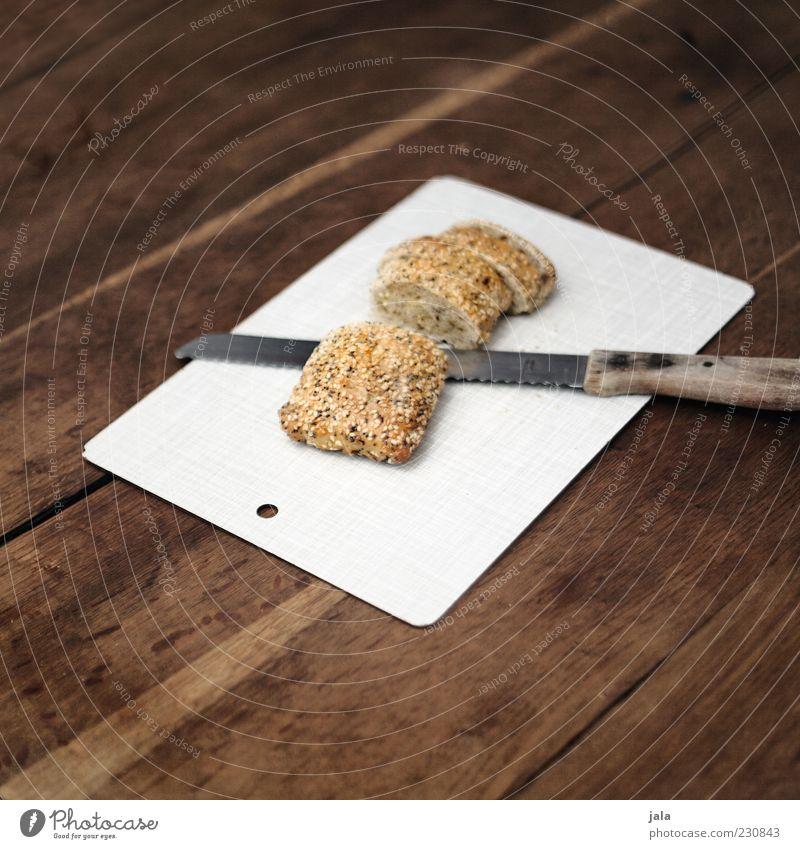 brötchen Lebensmittel Brötchen Ernährung Bioprodukte Vegetarische Ernährung Messer Holz frisch Gesundheit lecker Schneidebrett brotmesser Tisch Scheibe Farbfoto