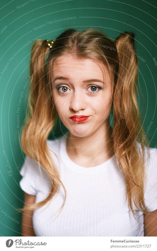 Young blonde girl with two braids Stil feminin Junge Frau Jugendliche Erwachsene 1 Mensch 18-30 Jahre schön trotzig Grimasse lustig Zopf 2 Haare & Frisuren
