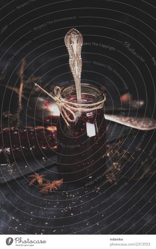 Himbeermarmelade im Glasglas Frucht Brot Dessert Marmelade Essen Frühstück Löffel Tisch Holz frisch lecker natürlich saftig schwarz Farbe Himbeeren süß
