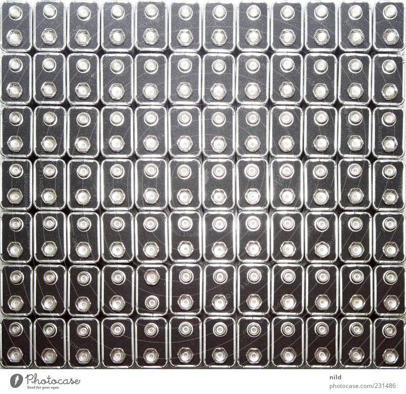 From out of space on low Battery Batterie Metall schwarz silber Umweltverschmutzung Elektrizität verschwenden Reihe Studioaufnahme Muster Strukturen & Formen