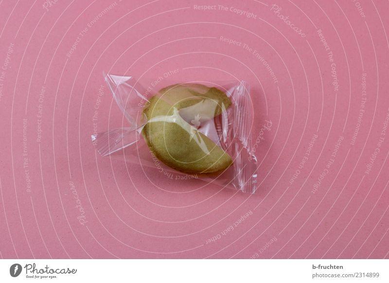 Glückskeks in Plastikhülle Süßwaren rosa Überraschung Erfolg Verpackung Hülle Asien Neugier Idee Farbfoto Innenaufnahme Studioaufnahme Menschenleer