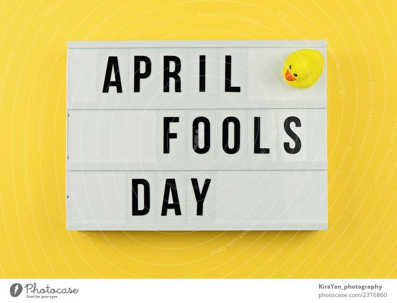 Text Aprilscherztag im Leuchtkasten auf gelb Freude Entertainment Feste & Feiern Frühling Spielzeug Kasten Lächeln lachen lustig Stimmung Optimismus