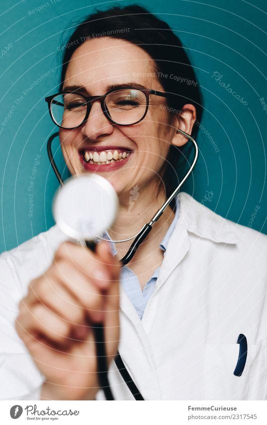 Female doctor fooling around with her stethoscope Arbeit & Erwerbstätigkeit Beruf Arzt feminin Junge Frau Jugendliche Erwachsene 1 Mensch 18-30 Jahre