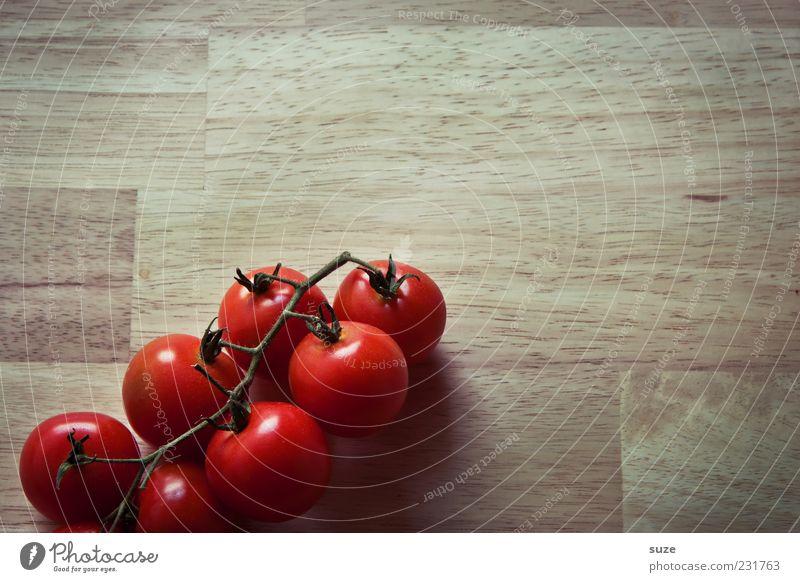 Familie Heinz Lebensmittel Gemüse Ernährung Bioprodukte Vegetarische Ernährung Gesunde Ernährung lecker rund braun rot Tomate Küchentisch Strauchtomate