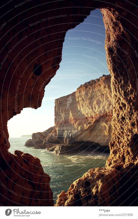 kompartibel. Carvoeiro Meer Atlantik Küste Klippe Felsküste Algarve Portugal Riff Höhle Durchblick Rahmen Sandstein Abenddämmerung Tuffstein Wellen Loch Stein
