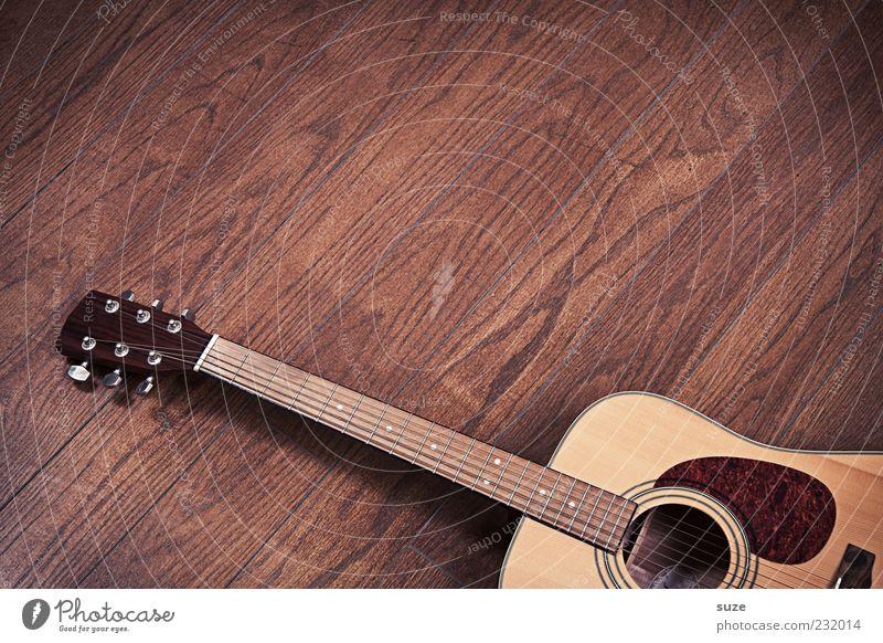 Bodenschatz Musik Gitarre Holz authentisch einfach natürlich braun Musikinstrument Saite Klang Griffbrett Holzfußboden Maserung liegen Parkett Laminat kultig