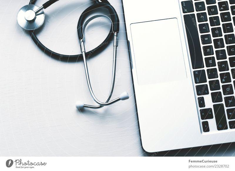 Doctor's stethoscope and laptop on table Arbeit & Erwerbstätigkeit Beruf Arzt kompetent Stethoskop Notebook Tischplatte Medikament Krankenhaus Sprechstunde