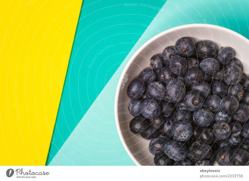Heidelbeerenfrucht in Schale, Bunter Hintergrund, Frucht Dessert Ernährung Essen Vegetarische Ernährung Diät Saft Schalen & Schüsseln Sommer Garten Küche