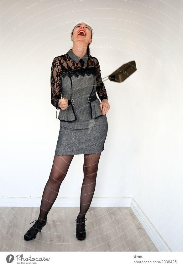 Mia Raum feminin Frau Erwachsene 1 Mensch Kleid Handtasche Stiefel schwarzhaarig langhaarig Bewegung drehen festhalten lachen stehen frech Fröhlichkeit frisch