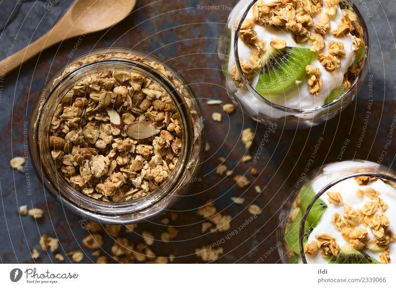 Knuspriges Granola und Parfait Lebensmittel Joghurt Frucht Getreide Dessert Ernährung Frühstück Gesundheit Müsli knackig Hafer Haferflocken Mandel süß Snack