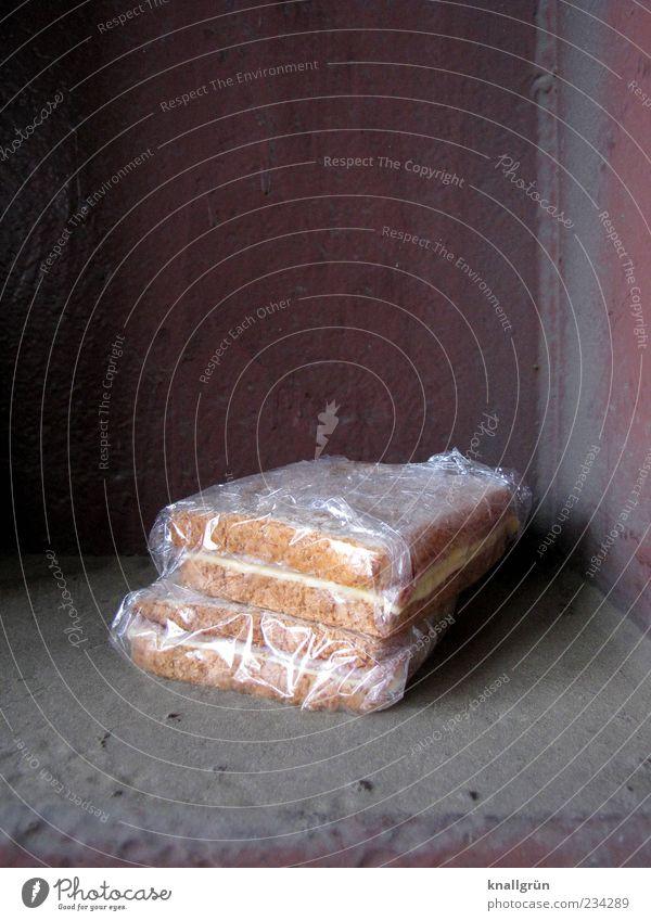 Pausenbrot gelb Ernährung Wand Lebensmittel braun Energie liegen frisch Ecke genießen Quadrat Frühstück lecker Brot durchsichtig eckig