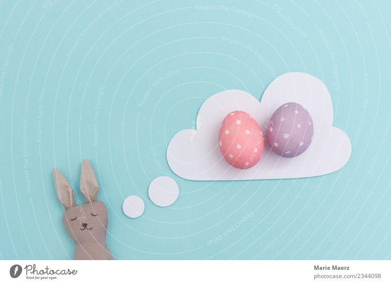 Müder Osterhase träumt von bunten Ostereiern Freude Ostern schlafen träumen Fröhlichkeit lustig blau rosa Zufriedenheit Vorfreude fleißig Müdigkeit Erholung