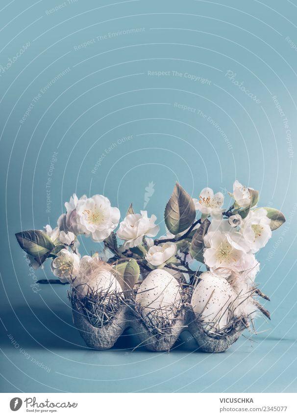 Ostereier mit weißen Blüten auf Blau Stil Design Dekoration & Verzierung Feste & Feiern Ostern Frühling Blatt Blumenstrauß Zeichen Tradition Hintergrundbild