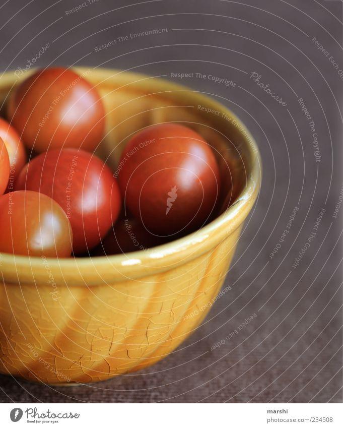 rote Bällchen gelb Lebensmittel klein braun glänzend mehrere rund Gemüse lecker Bioprodukte Schalen & Schüsseln Vegetarische Ernährung geschmackvoll Tomate