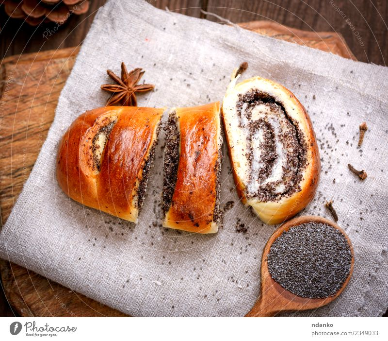 Essen Holz braun oben frisch Tisch lecker Tradition Mohn Dessert heimwärts Brot Backwaren Mahlzeit Scheibe Schneidebrett