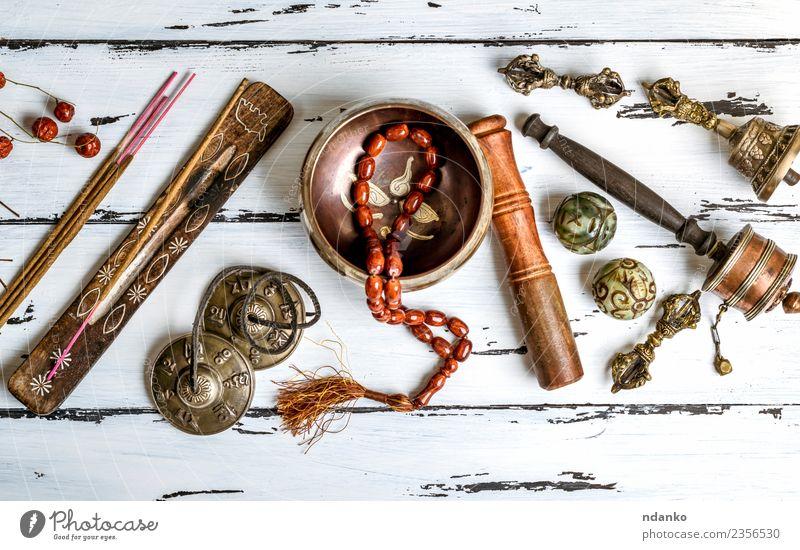 Tibetische religiöse Objekte Behandlung Alternativmedizin Medikament harmonisch Meditation Werkzeug Stein Holz alt oben retro braun weiß Stress Energie Erholung