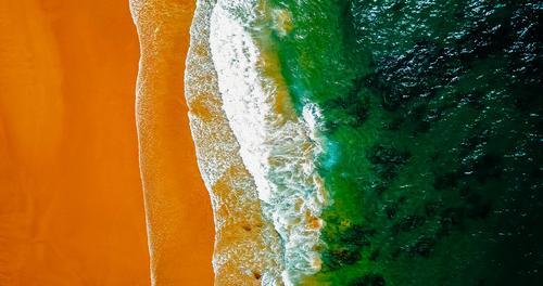 Luftaufnahme der Meereswellen und des wunderschönen Strandes in Portugal Umwelt Natur Landschaft Sand Wasser Sommer Wetter Schönes Wetter Wärme Wellen Küste