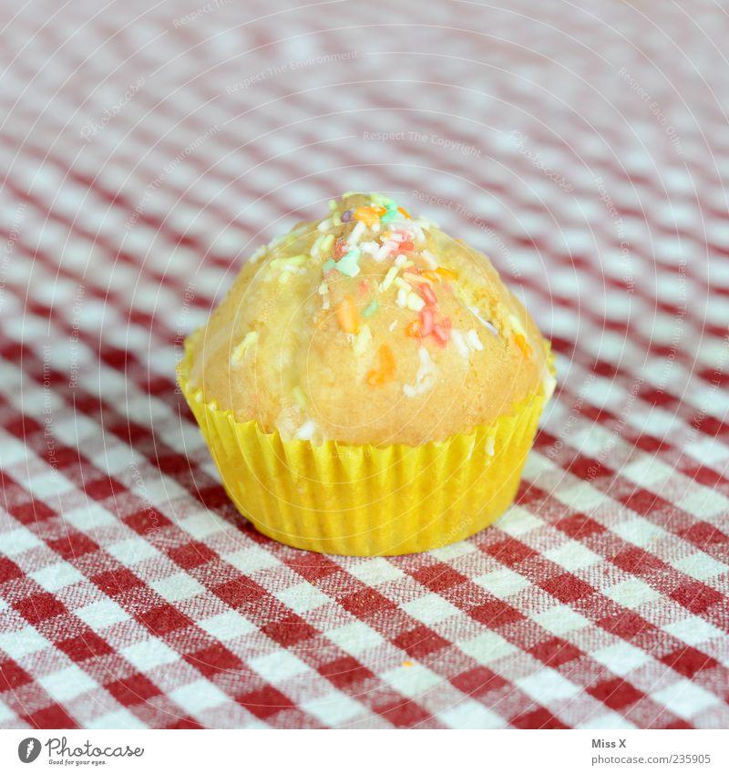 Muffin gelb Ernährung Lebensmittel klein süß Kuchen lecker kariert Backwaren Dessert Teigwaren Tischwäsche Muffin Gerät Muster Backform