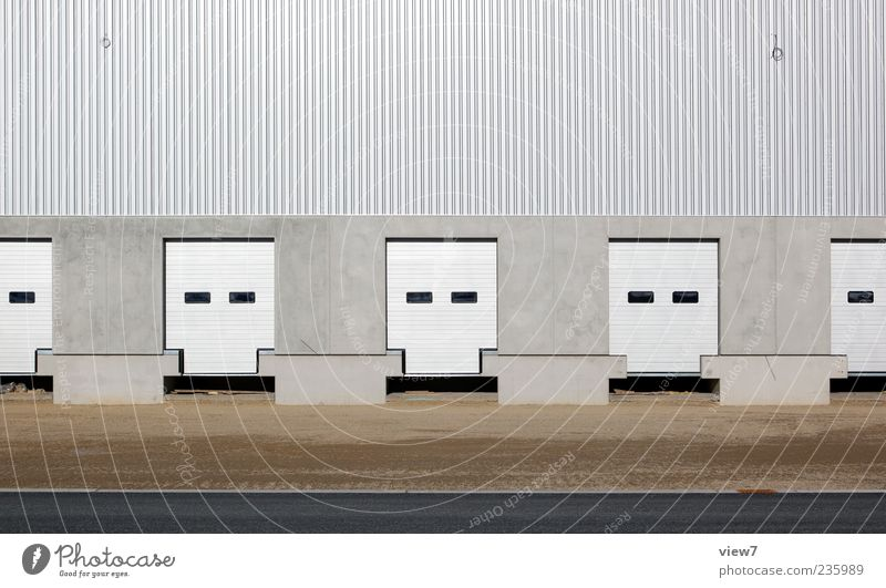 again and again and ... Ferne Wand grau Stein Mauer Gebäude Linie braun Fassade Ordnung Beton modern authentisch neu Streifen einzigartig