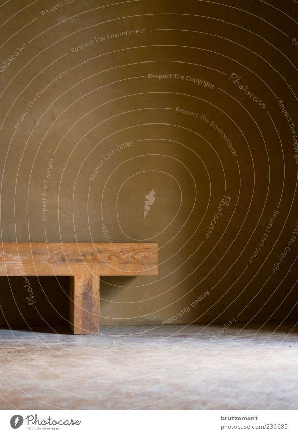 T-time Stil Häusliches Leben Mauer Wand Stein Holz ästhetisch eckig braun Gelassenheit ruhig Meditation Lehmputz Bank Gedeckte Farben Innenaufnahme Menschenleer
