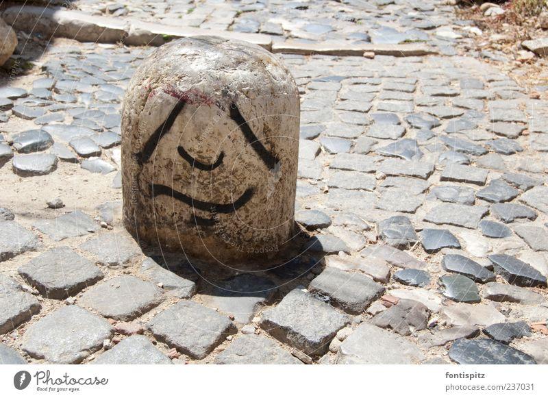 The hard life of a stone schwarz Graffiti grau Stein Traurigkeit Gesichtsausdruck Langeweile Poller