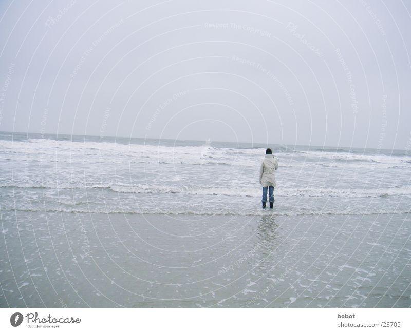 Lonely one Wolken Meer See Gischt Strand nass kalt Jacke Mütze Stiefel Wattenmeer whoiscocoon