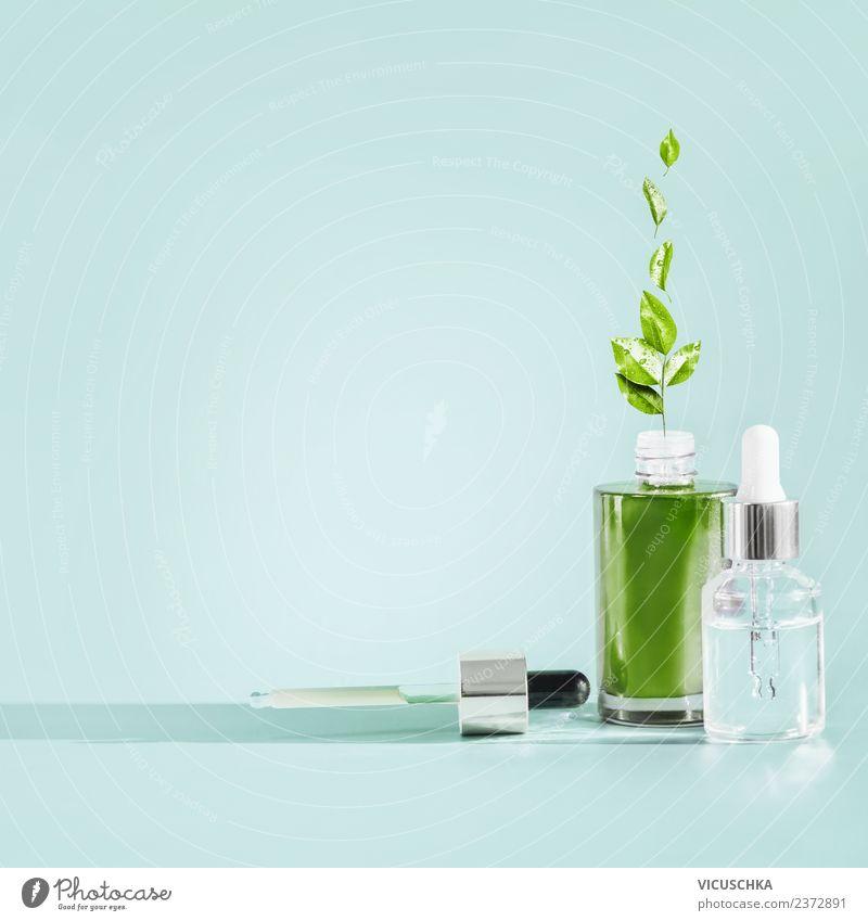 Naturkosmetik. Serum und Gesichtsöl Flaschen mit Pflanzen schön grün Gesundheit Hintergrundbild Gesundheitswesen Stil Design Glas kaufen Wellness