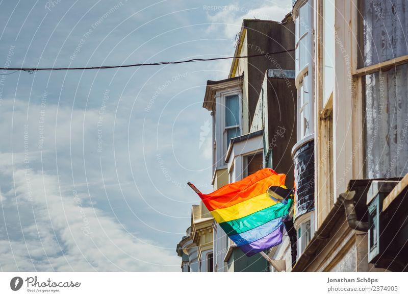 rainbow flag in the city blau Stadt grün rot Haus Fenster gelb Bewegung Freiheit orange Europa Zeichen Streifen violett Frieden Fahne