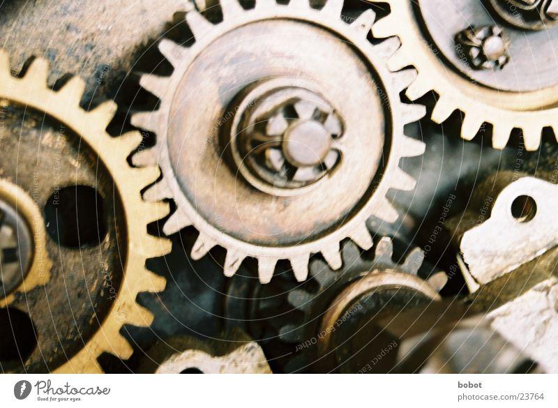 Zähne zusammen beißen Maschine Antrieb rotieren drehen Drehung Uhrwerk Elektrisches Gerät Technik & Technologie Metall Zahnrad Erdöl Teamwork