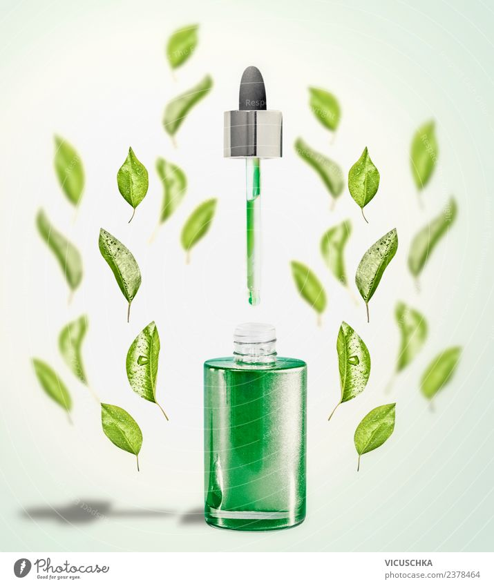 Grünes Gesichtsserum mit Pipette und grünen Blättern kaufen Stil Design schön Kosmetik Gesundheit Wellness Spa Natur Blatt Serum Hintergrundbild Flasche