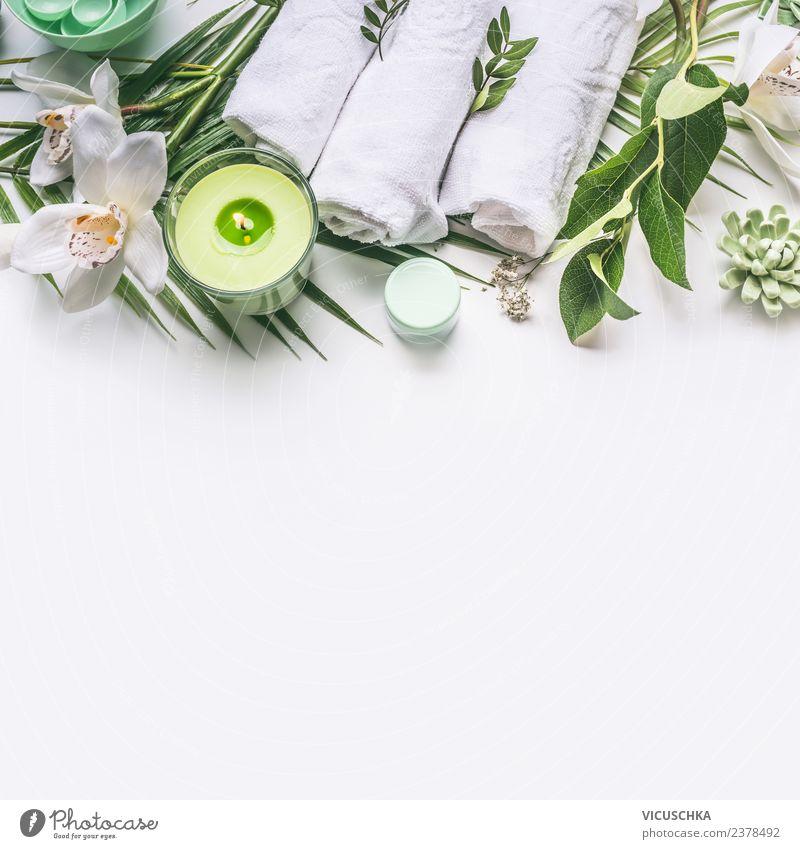 Grüner Spa Hintergrund mit Tuch, Kerze und Orchidee Stil Design schön Körperpflege Kosmetik Creme Wellness Erholung Bad Pflanze Blume rosa Hintergrundbild