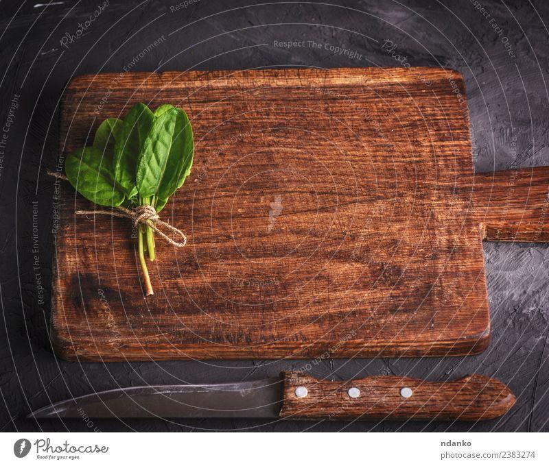 Schneidebrett und Bund mit grünem Sauerampfer Kräuter & Gewürze Tisch Küche Natur Pflanze Blatt Holz alt frisch natürlich oben braun schwarz Hintergrund