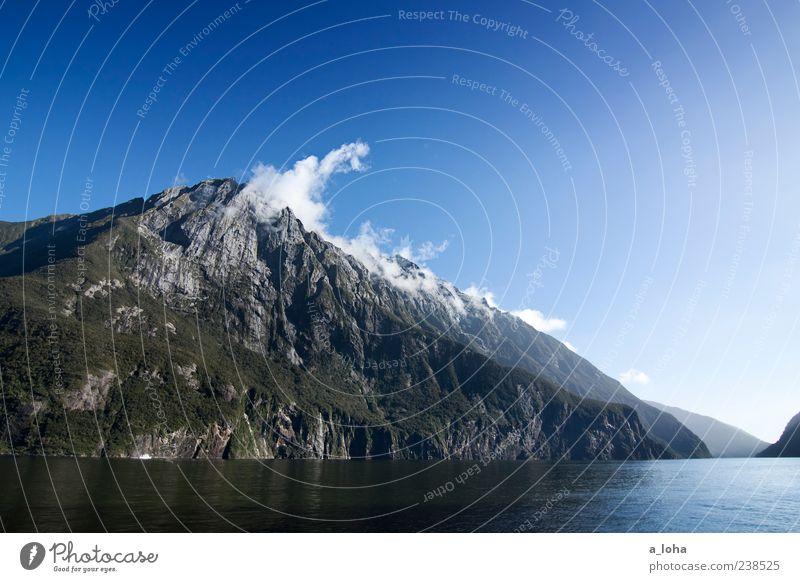 wonderland Himmel Natur blau Wasser Ferien & Urlaub & Reisen Pflanze Wolken Landschaft Berge u. Gebirge Küste Felsen Nebel authentisch Urelemente Schönes Wetter Gipfel