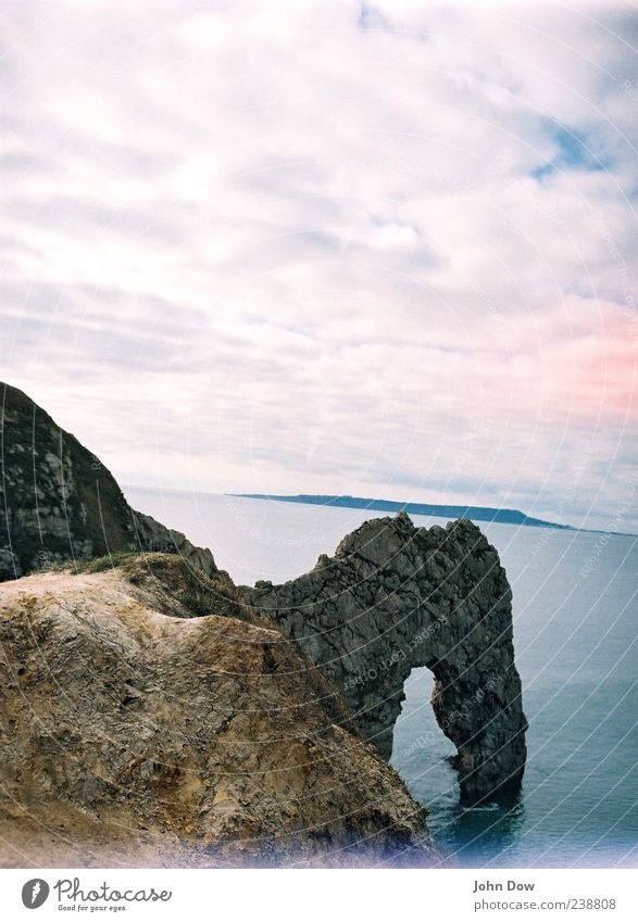 Durdle Door Meer Wolken Ferne Landschaft Küste Freiheit Felsen außergewöhnlich Schönes Wetter Hügel Aussicht Bucht analog England Bogen Felsbogen