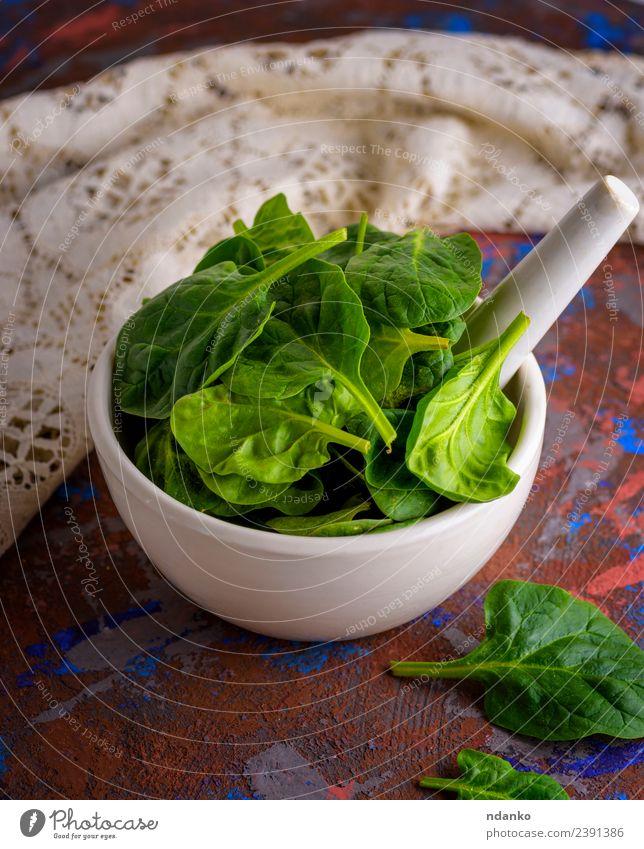 frische grüne Spinatblätter Gemüse Salat Salatbeilage Ernährung Vegetarische Ernährung Diät Teller Schalen & Schüsseln Tisch Natur Pflanze Blatt Holz natürlich