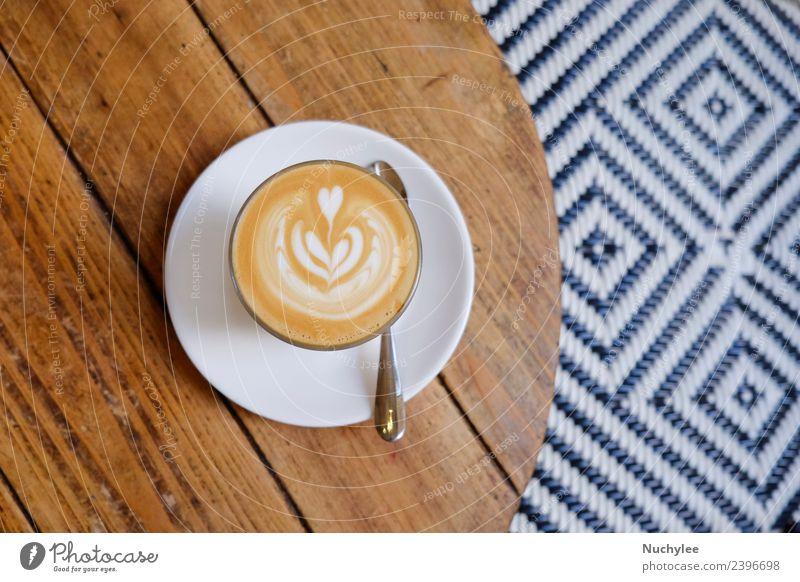 Draufsicht auf den heißen Kaffeemilchkaffee Frühstück Getränk Espresso Stil Design Schreibtisch Tisch Restaurant Kunst Holz frisch braun schwarz weiß Top