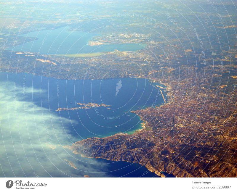 heimflug Himmel blau Wasser Meer Ferne Landschaft Berge u. Gebirge Küste Erde braun fliegen einzigartig Hafenstadt Flugzeugausblick
